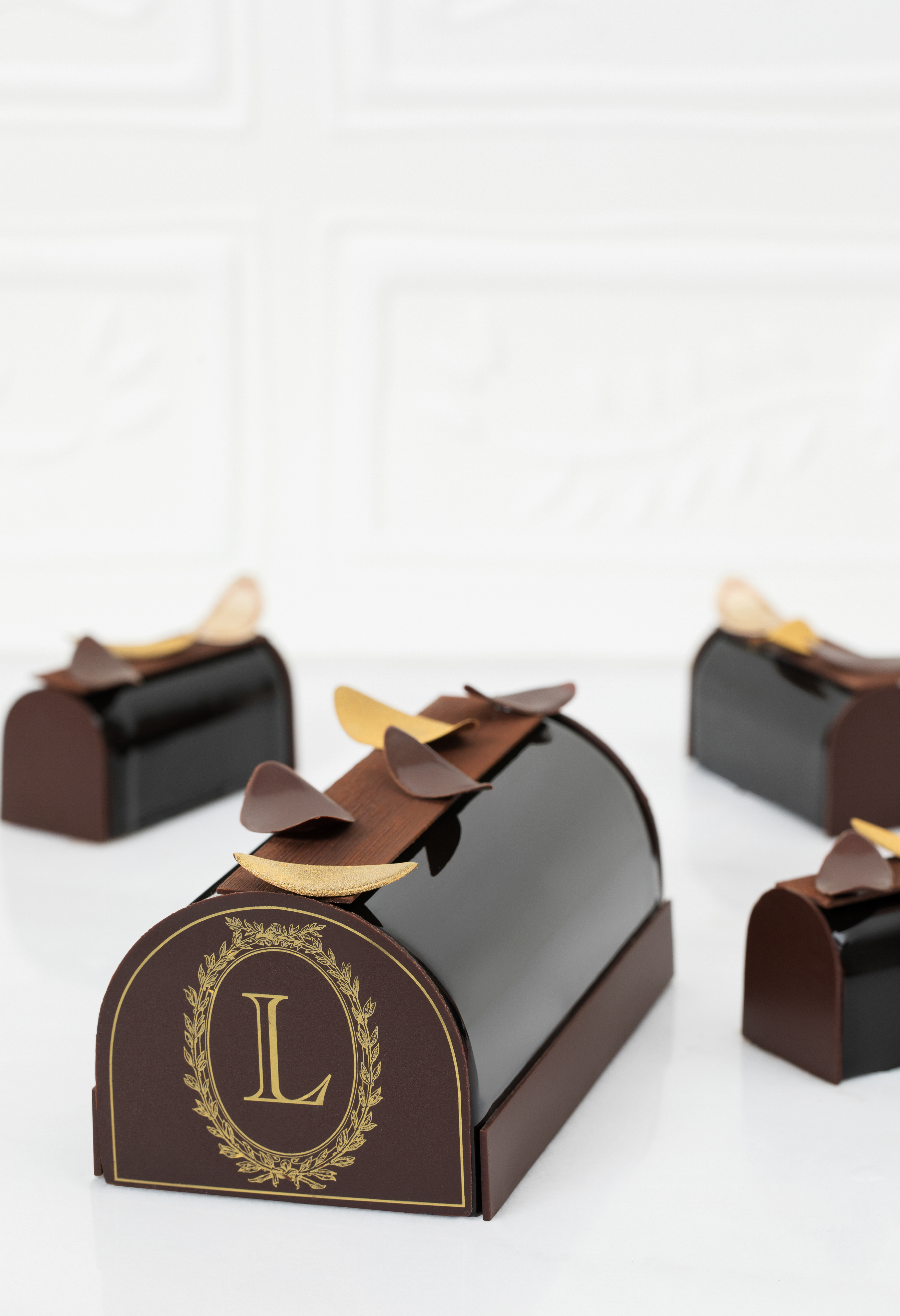 Four beautifully crafted Yule logs vie for your affections: hazelnut, rose-raspberry, chocolate, and almond. (Image: Courtesy Laduree)<p></p>