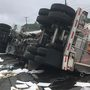 Crews cleaning up diesel fuel after tractor trailer overturns on Route 460