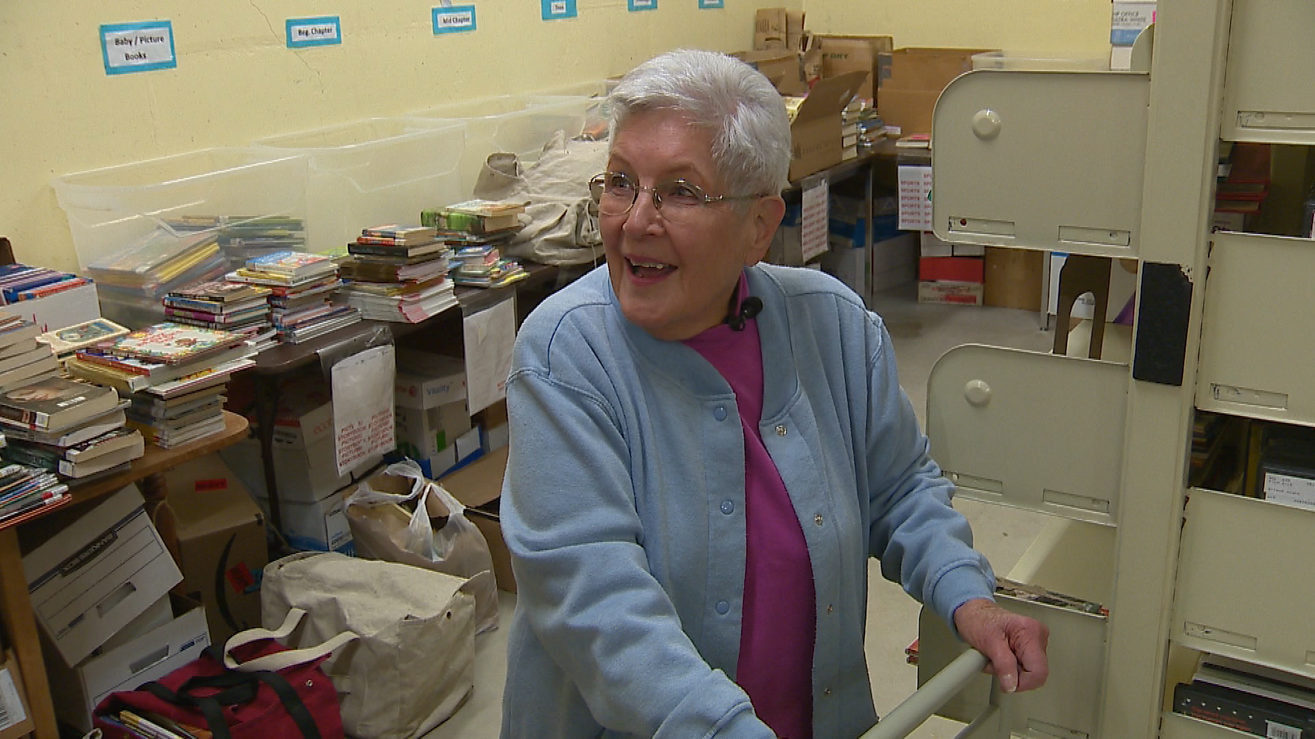 93-year-old Anita Powers has been sorting and stacking books at the Central Branch of the Brown County Library for 15 years. (Courtesy WLUK)<p></p>