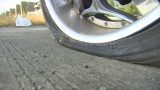Broken expansion joint flattens tires during morning commute