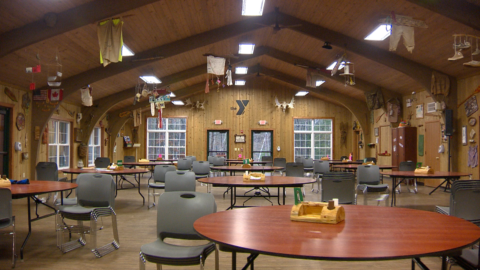 Camp cafeteria has round tables to promote more interaction among campers (WLUK)<p></p>