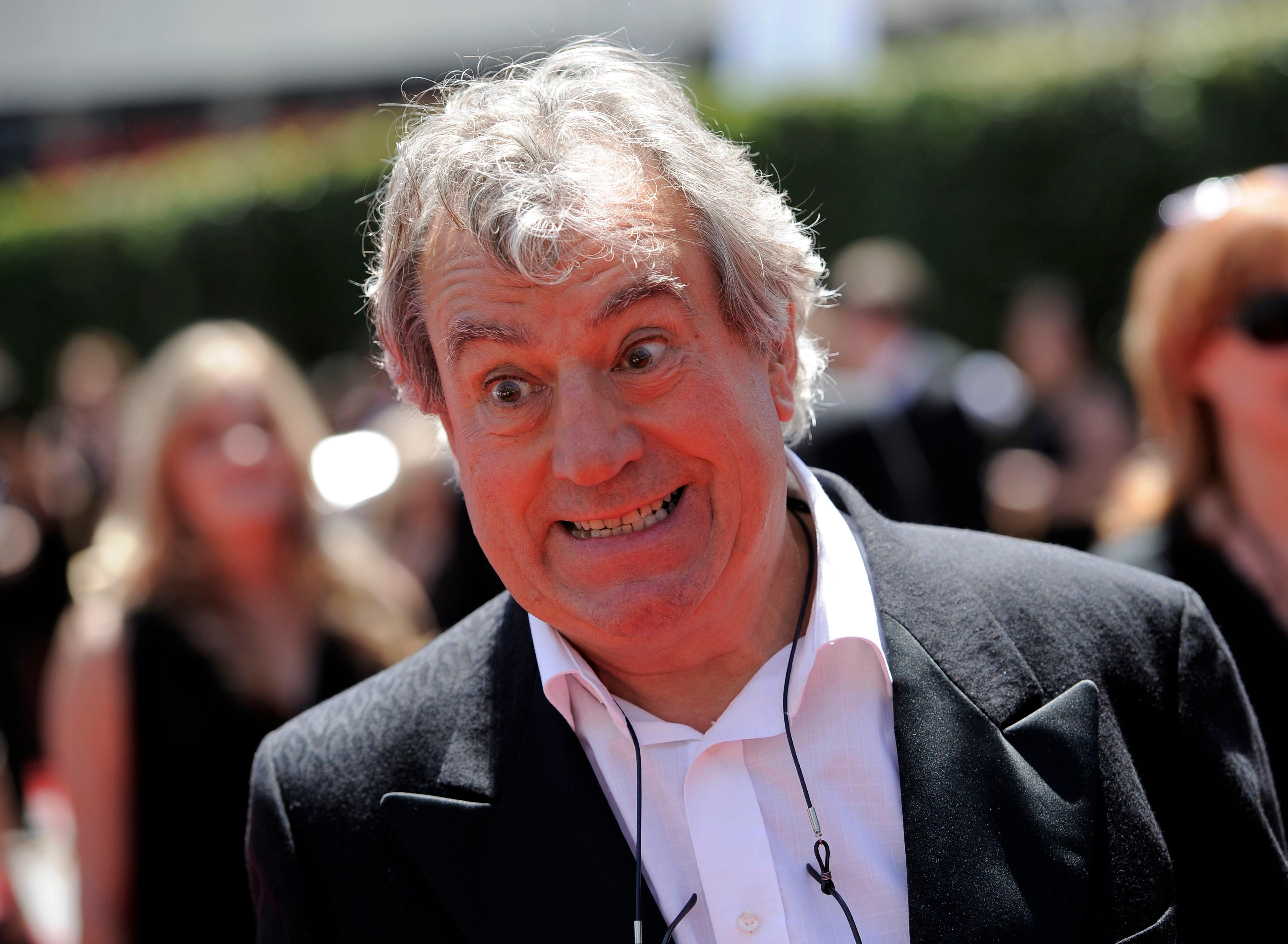 FILE - In this Saturday, Aug. 21, 2010 file photo, Terry Jones arrives at the Creative Arts Emmy Awards in Los Angeles. (AP Photo/Chris Pizzello, file)