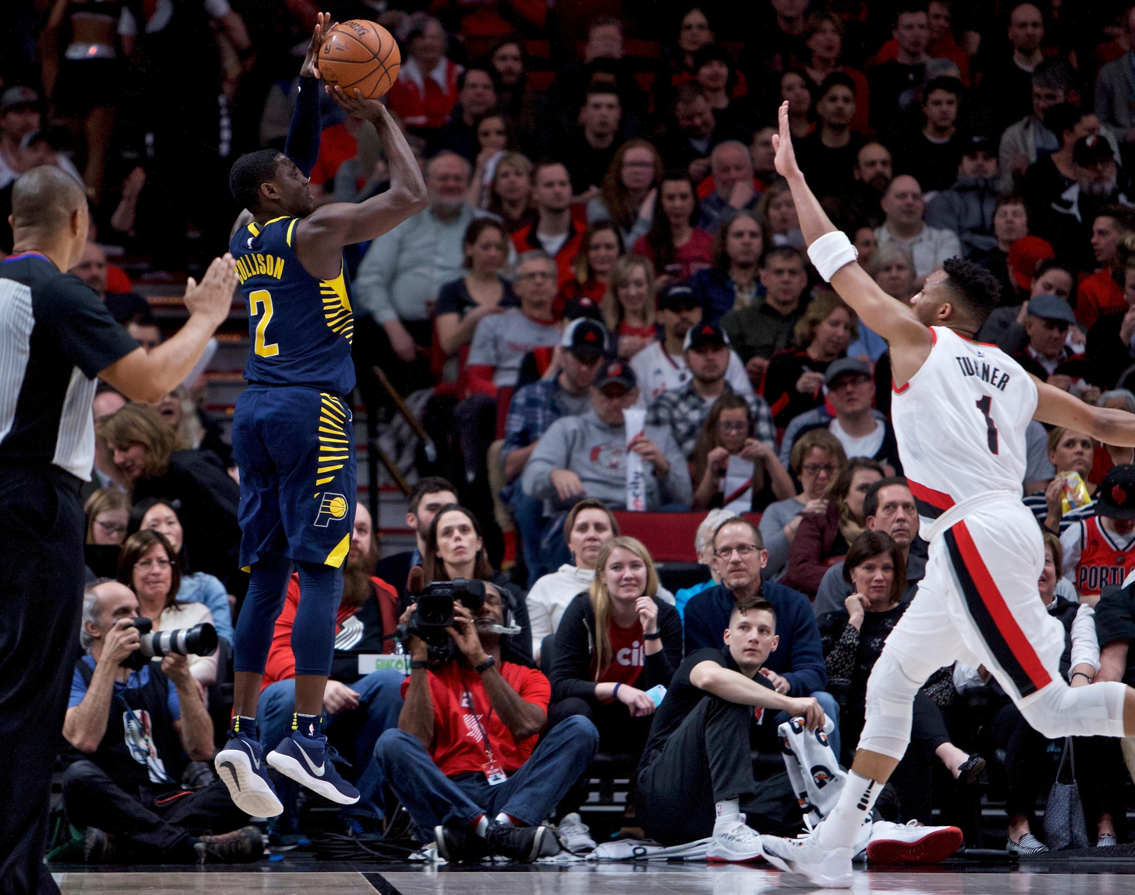 Indiana Pacers guard Darren Collison, left, shoots over Portland Trail Blazers guard Evan Turner during the second half of an NBA basketball game in Portland, Ore., Thursday, Jan. 18, 2018. (AP Photo/Craig Mitchelldyer)
