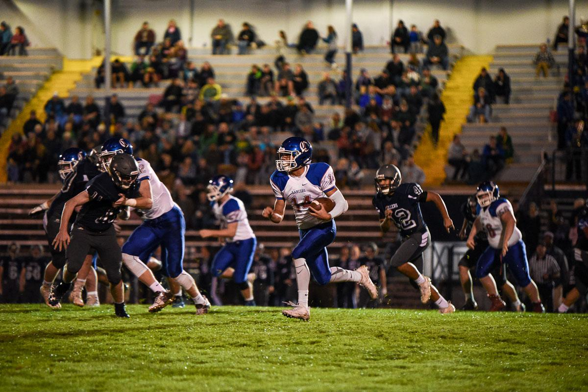 Churchill wide receiver Myles Green-Richards (#14) rushes for a gain in the Lancer's 56-7 victory over Springfield remaining 7-0 on the season. Photo by Jeff Dean, Oregon News Lab