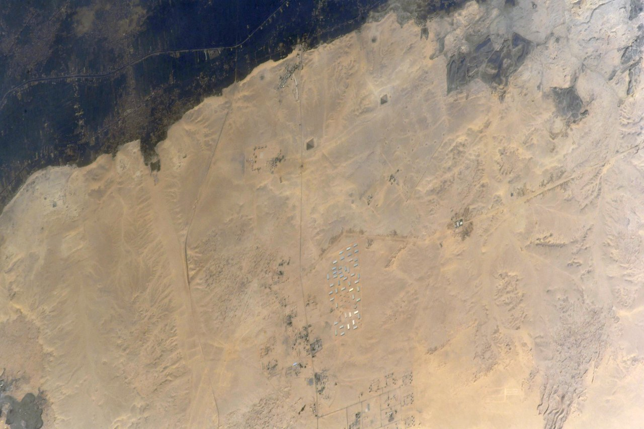The #ISS over the greatest architectural monuments of Ancient #Egypt. At this photo you can see the Red Pyramid, the Bent Pyramid and the Black Pyramid located at the Dahshur necropolis. (Photo & Caption: Oleg Artemyev / NASA)