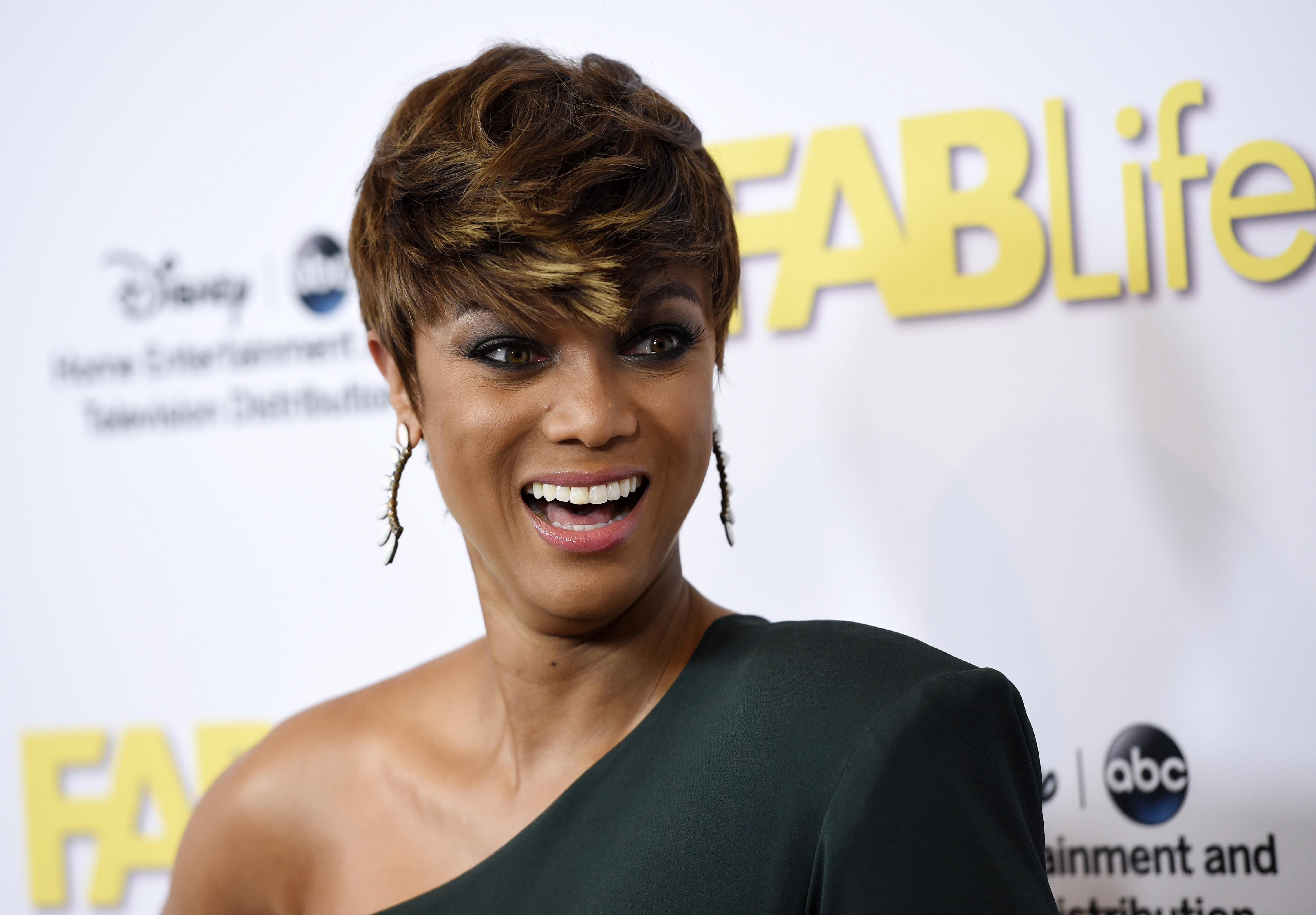 "FILE - In this Aug. 4, 2015 file photo, Tyra Banks poses at the Disney ABC Television Group party during the 2015 Television Critics Association Summer Press Tour at the Beverly Hilton in Beverly Hills, Calif. Banks is ""scaling back"" involvement with her new life-style show, ""FABLife."" Original billed as ""chief stylist"" on the show, which also features four other co-hosts, Banks has made the decision to ""scale back"" her role, the show's publicist said Friday, Nov. 20, 2015. (Photo by Chris Pizzello/Invision/AP, File)"