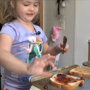 5-year-old girl spread peanut butter, jelly and love to firefighters at a mulch fire