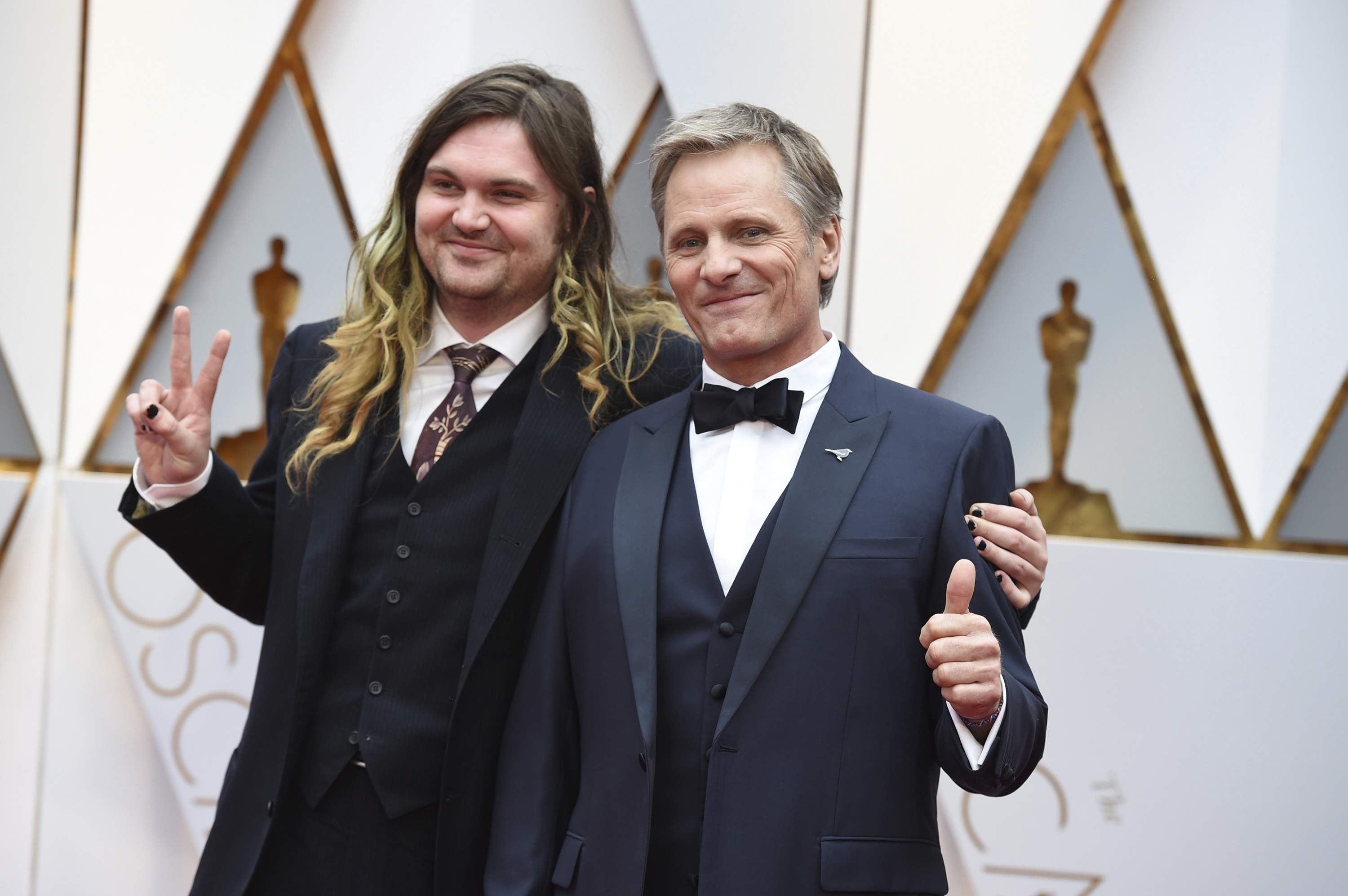 Henry Mortensen, left, and Viggo Mortensen arrive at the Oscars on Sunday, Feb. 26, 2017, at the Dolby Theatre in Los Angeles. THE ASSOCIATED PRESS