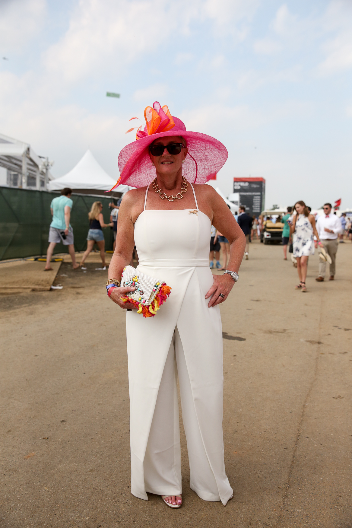 White is a great choice for those especially hot days, but it doesn't have to be boring or overly formal! We love how this jumpsuit was brightened up with punchy accessories at the Preakness Stakes.{ }(Amanda Andrade-Rhoades/DC Refined)