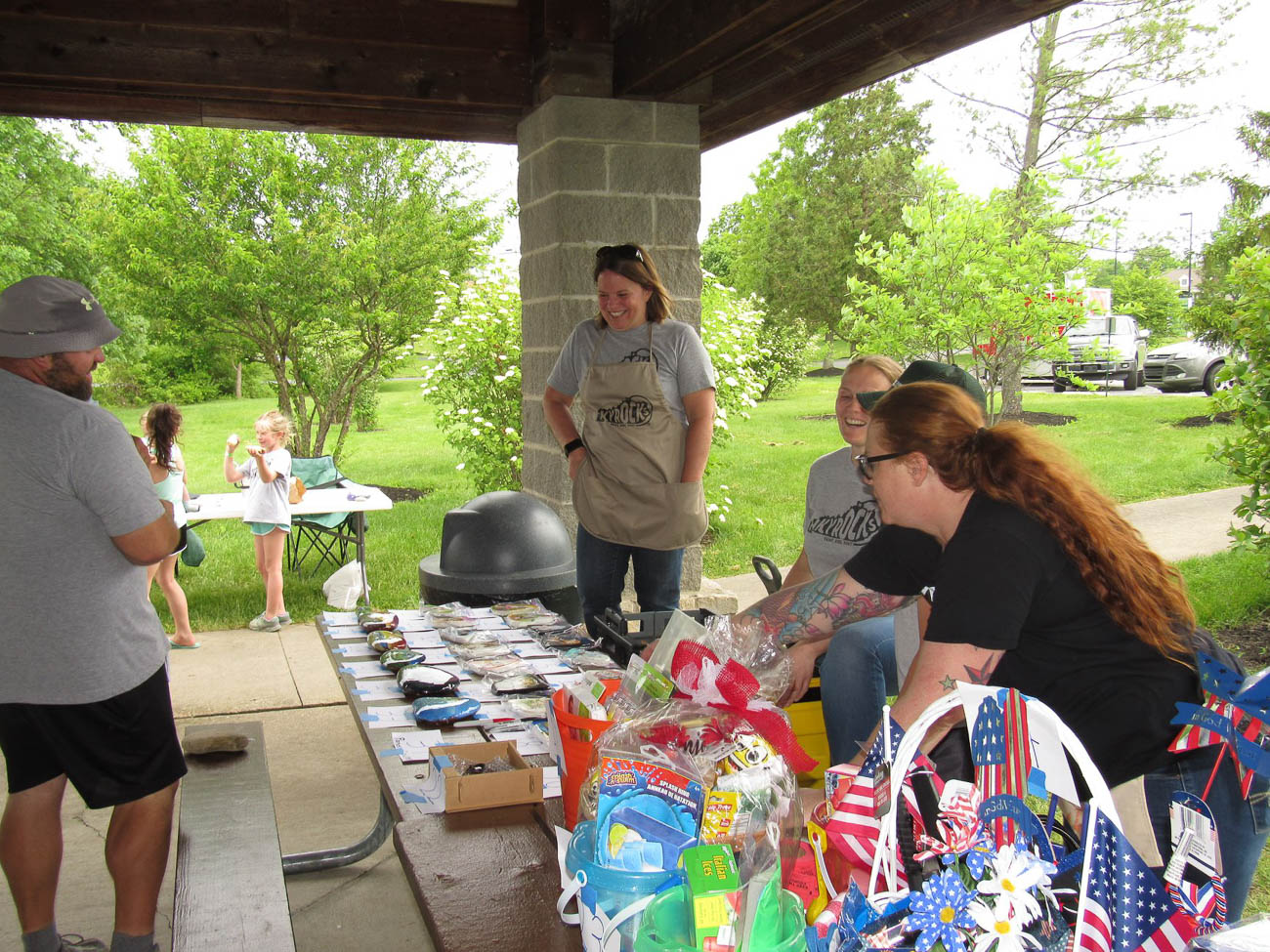 When the group hosts rock-hunting events, they partner with non-profits in the community to raise money for different causes by auctioning off items. A few organizations they've worked with are the Children's Home of Northern Kentucky, Stray Animal Adoption Program (SAAP), and Vivian's Victory—a group that helps families who have a child with an illness or disability financially and emotionally. / Image: Nancy Fedders     // Published: 8.17.19