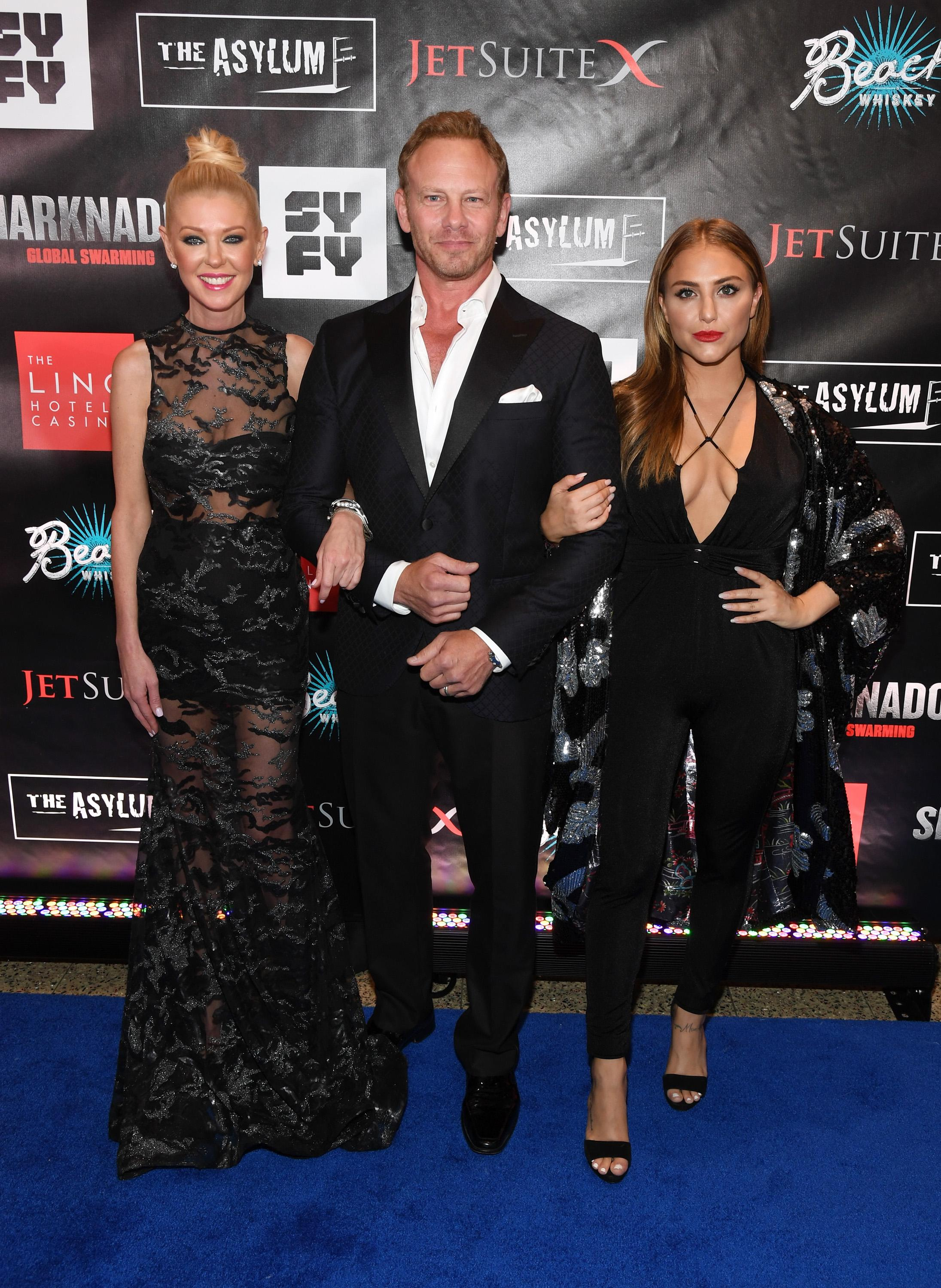 "LAS VEGAS, NV - AUGUST 06:  (L-R) Actress Tara Reid, actor Ian Ziering and actress Cassie Scerbo attend the premiere of ""Sharknado 5: Global Swarming"" at The LINQ Hotel & Casino on August 6, 2017 in Las Vegas, Nevada.  (Photo by Ethan Miller/Getty Images for Caesars Entertainment )"
