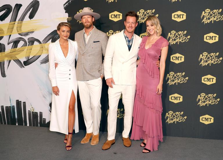 Brittney Marie Kelley, from left, Brian Kelley and Tyler Hubbard, of Florida Georgia Line, and Hayley Hubbard arrive at the CMT Music Awards (AP Photo/Al Wagner)