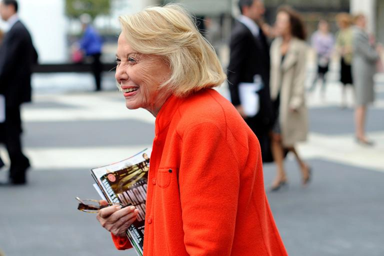 FILE- In this Aug. 9, 2009, file photo, Liz Smith leaves the Celebration of Life Memorial ceremony for Walter Cronkite at Avery Fisher Hall in New York. Smith, a gossip columnist whose mixture of banter, barbs, and bon mots about the glitterati helped her climb the A-list as high as many of the celebrities she covered, has died. Literary agent Joni Evans told The Associated Press she died in New York on Sunday, Nov. 12, 2017. She was 94. (AP Photo/Stephen Chernin, File)