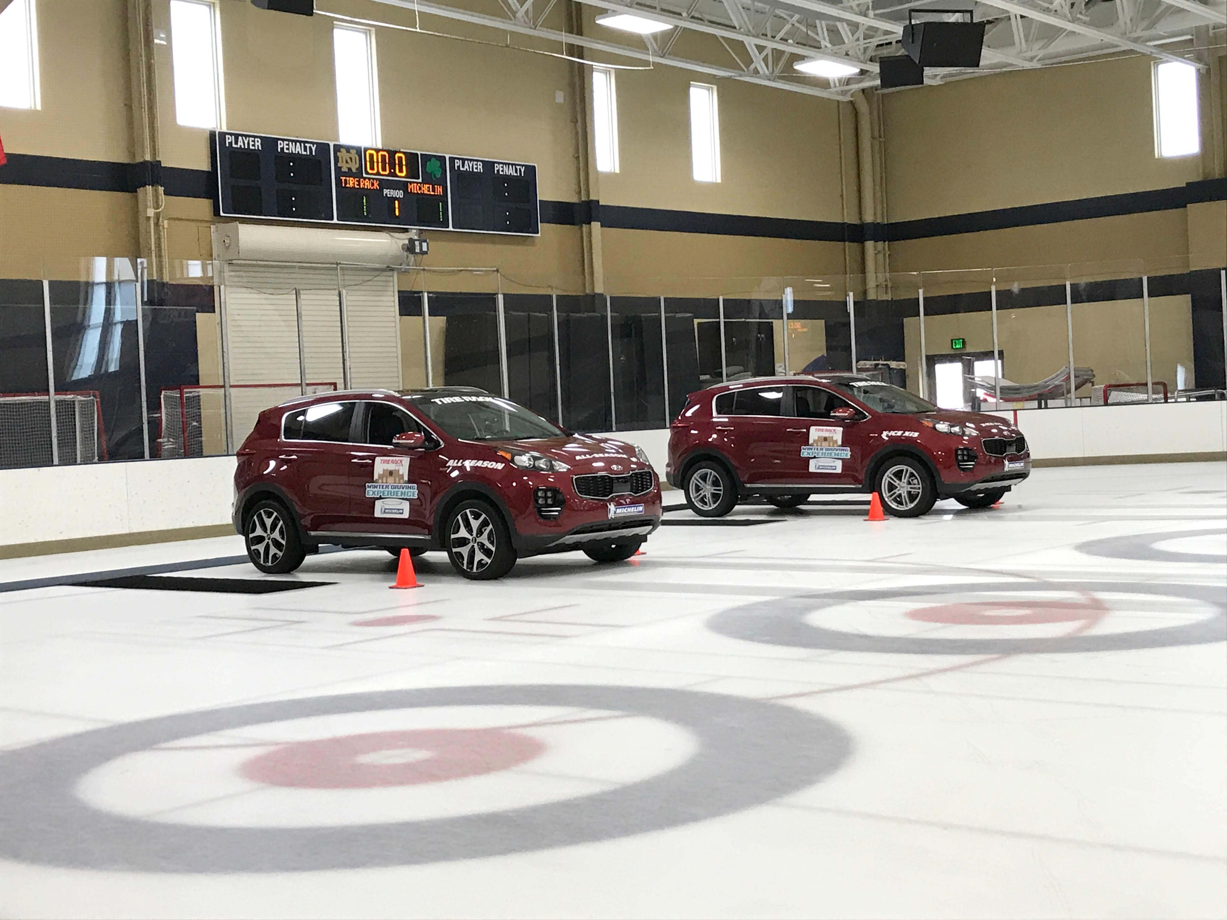 Two all-wheel-drive Kia Sportages lined up for a winter tire driving experiment. The car on the right has winter tires, the car on the left has all-season tires. (Sinclair Broadcast Group / Jill Ciminillo)<p></p>