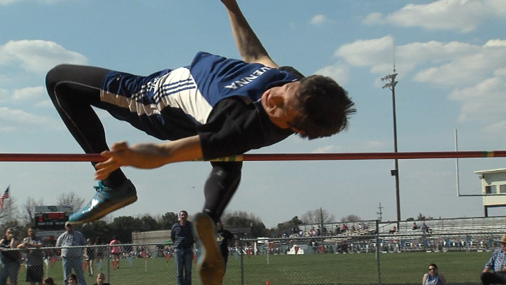 Josh Bauer of Ravenna skies over the 6-04.00 bar, April 23, 2018, in the Central Nebraska Track Championships high jump (KHGI)