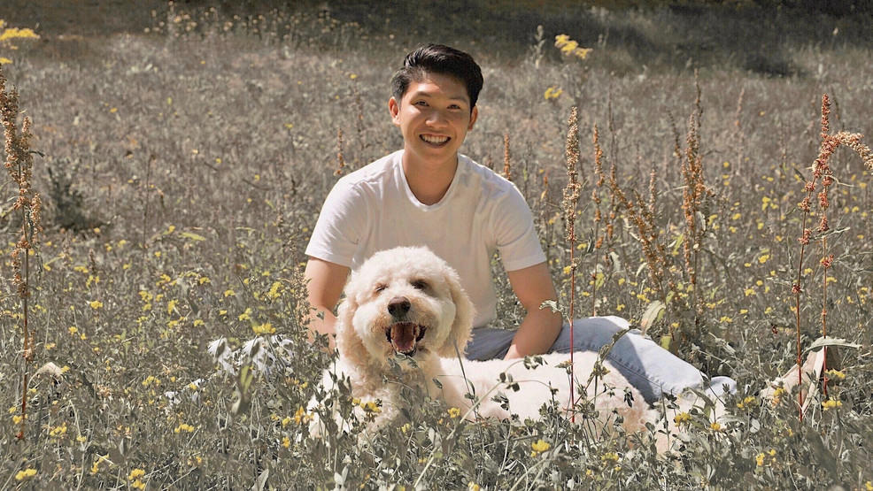 Alex and Dog in Field.jpg