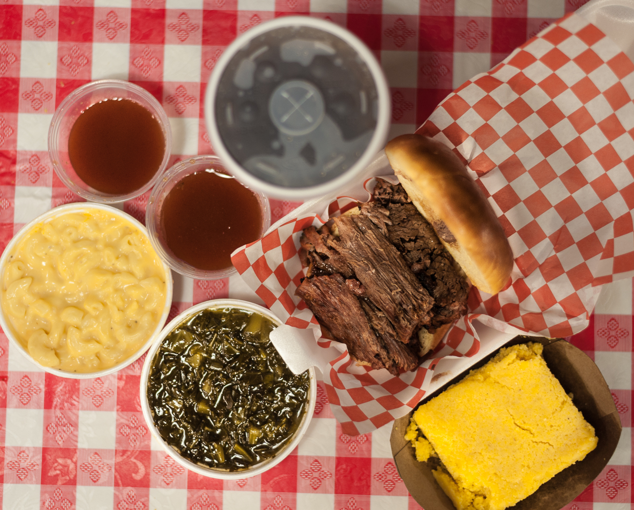 Collard greens, mac & cheese soft drink, full brisket sandwich, and sweet bread / Image: Kellie Coleman // Published: 6.19.20