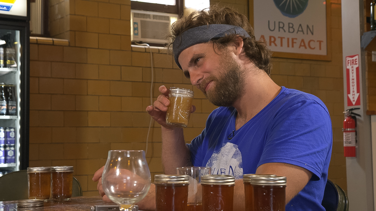 Bret Kollmann Baker, Director of Brewing Operations at Urban Artifact, samples beer made with wild-caught yeast collected from within and around a vat that dates back to before the Civil War. / Image courtesy of Seven/Seventy-Nine Video // Published: 11.5.18