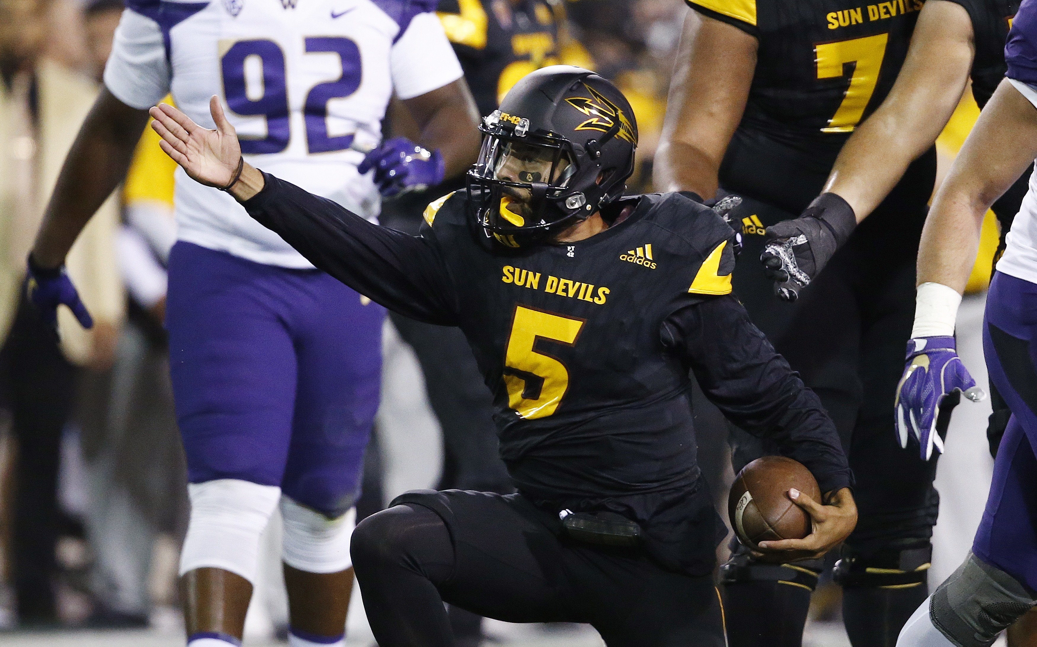 Arizona State quarterback Manny Wilkins (5) signals a first down against Washington during the first half of an NCAA college football game, Saturday, Oct. 14, 2017, in Tempe, Ariz. (AP Photo/Ross D. Franklin)