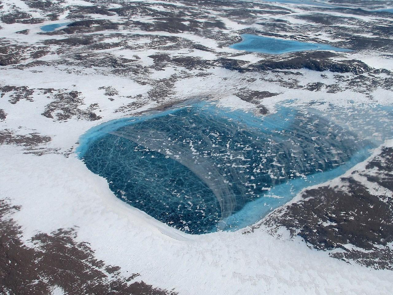 Frozen Greenland meltpond, Photo Date: May 2012 (NASA Goddard Space Flight Center / MGN)
