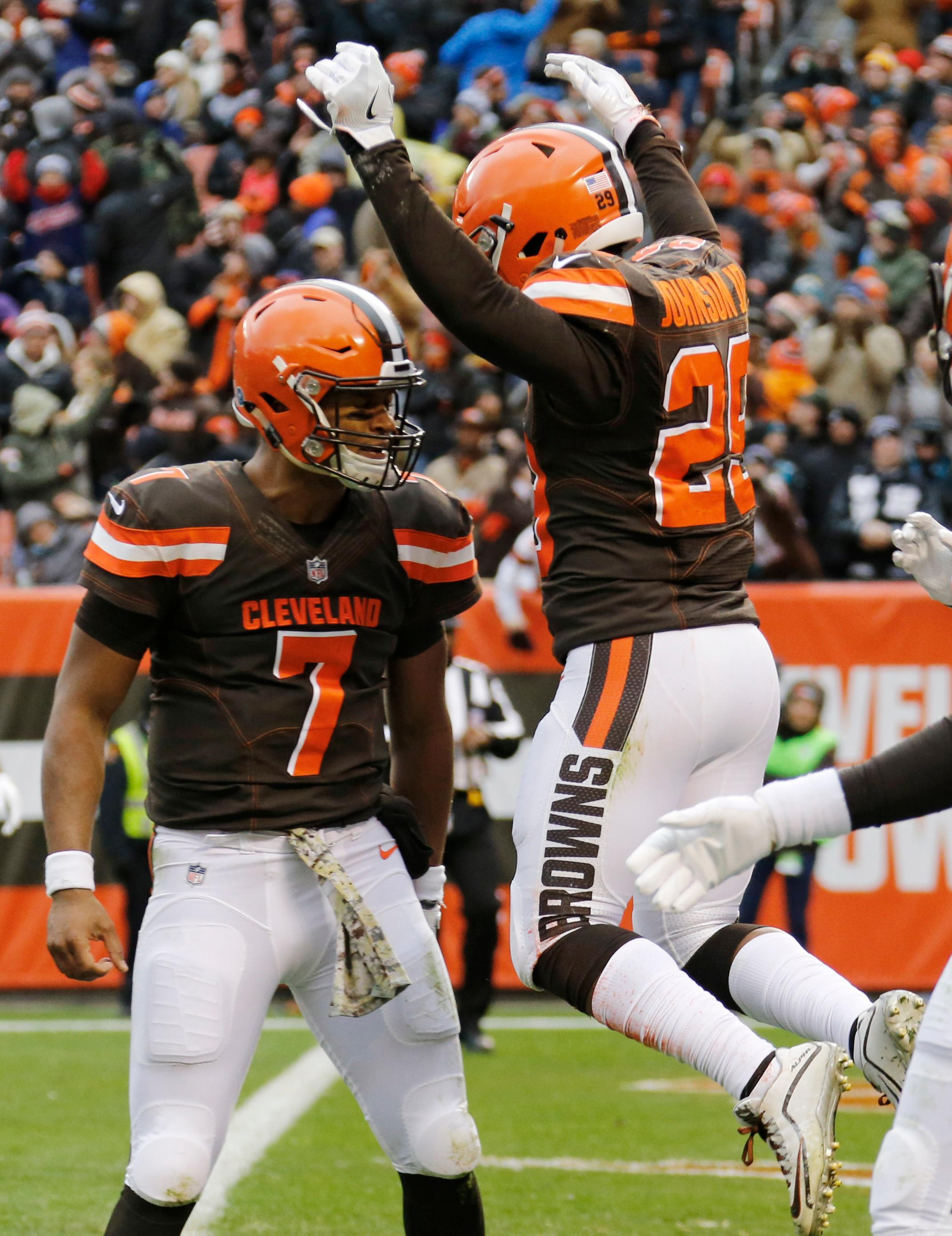 Cleveland Browns running back Duke Johnson, right, celebrates with quarterback DeShone Kizer, left, after scoring a touchdown after a 27-yard pass in the first half of an NFL football game against the Jacksonville Jaguars, Sunday, Nov. 19, 2017, in Cleveland. (AP Photo/Ron Schwane)