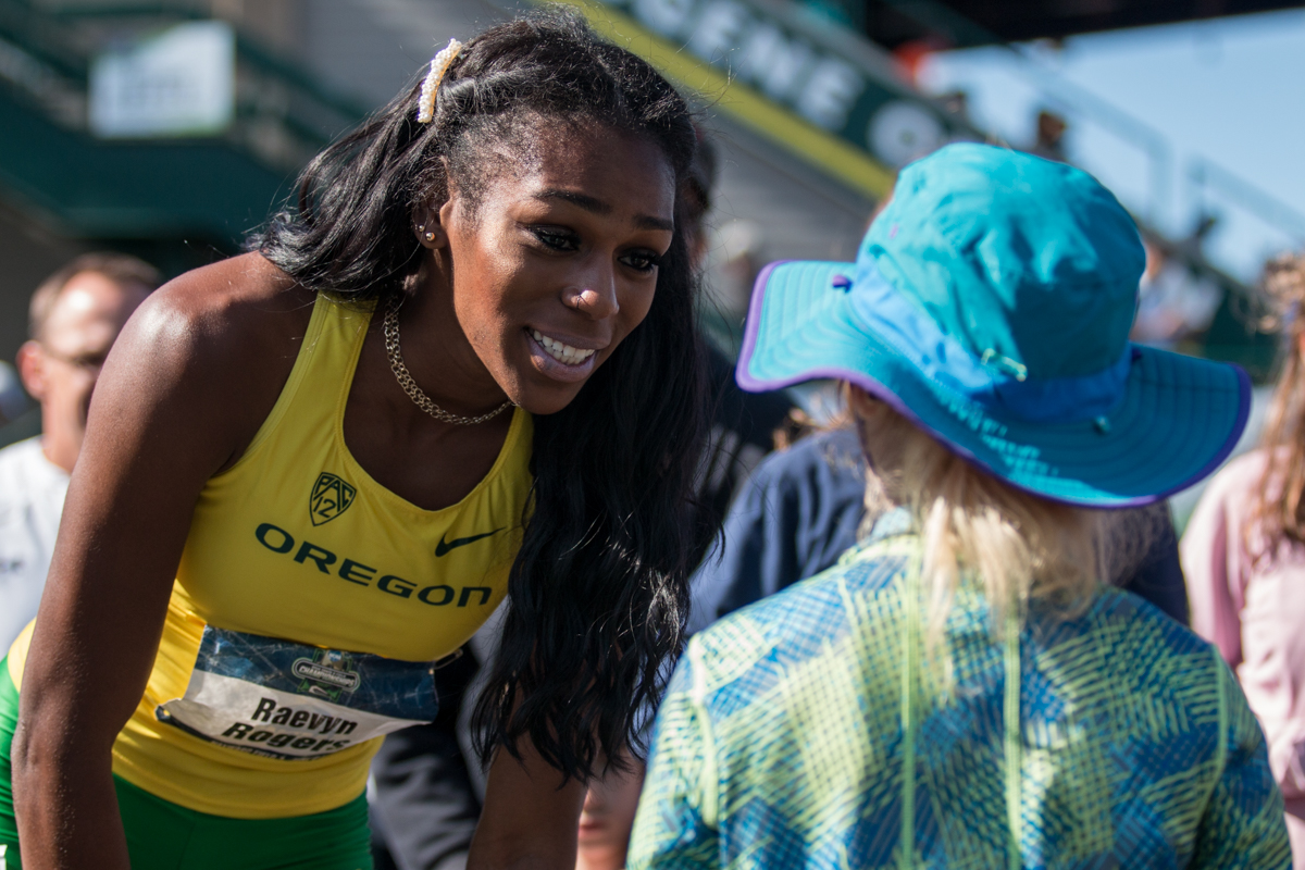 Raevyn Rogers of Oregon greets a young fan after winning the 800m title. Oregon News, Photo by Dillon Vibes