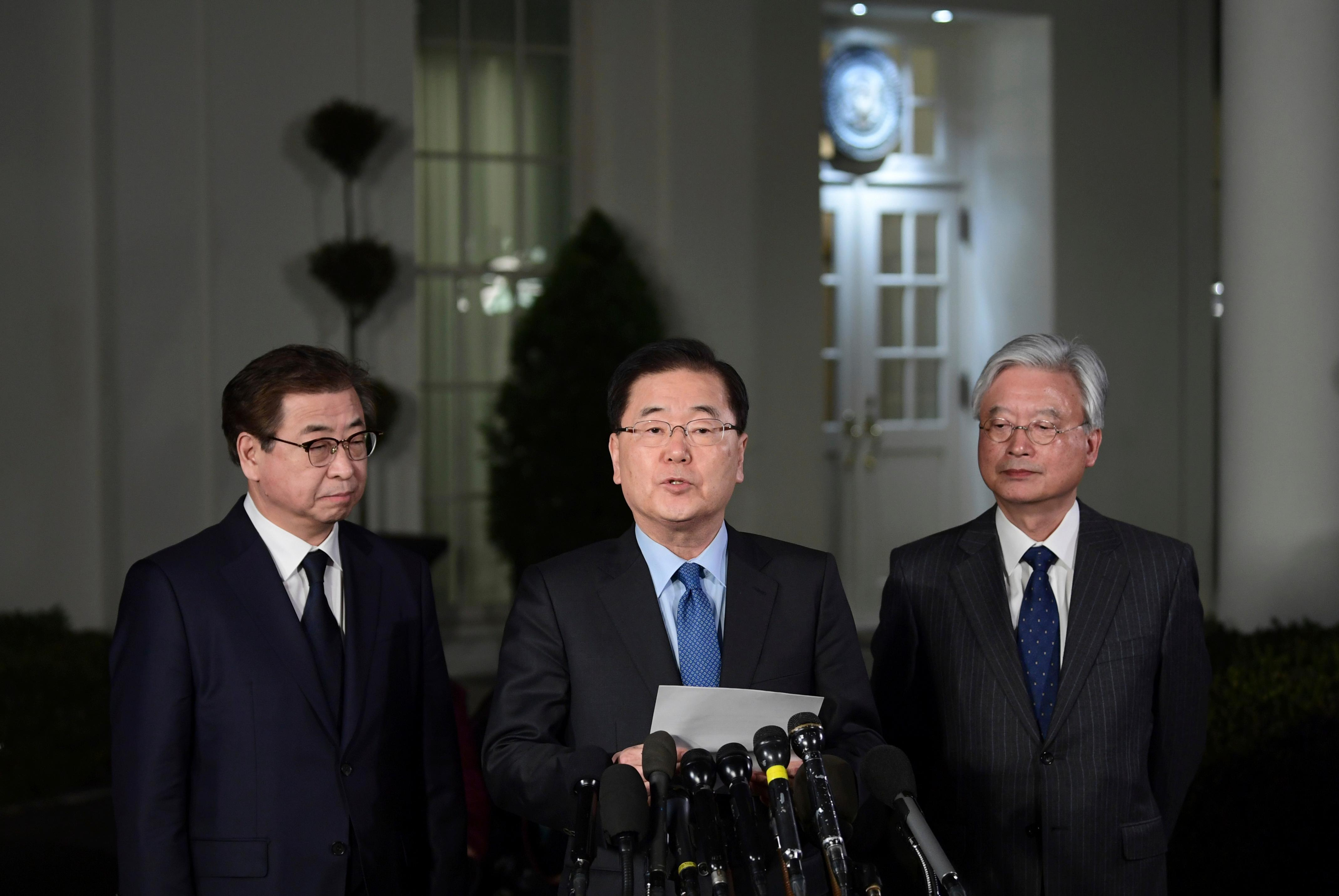 South Korean national security director Chung Eui-yong, center, speaks to reporters at the White House in Washington, Thursday, March 8, 2018. Intelligence chief Suh Hoon is at left. President Donald Trump has accepted an offer of a summit from the North Korean leader and will meet with Kim Jong Un by May, a top South Korean official said Thursday, in a remarkable turnaround in relations between two historic adversaries. (AP Photo/Susan Walsh)