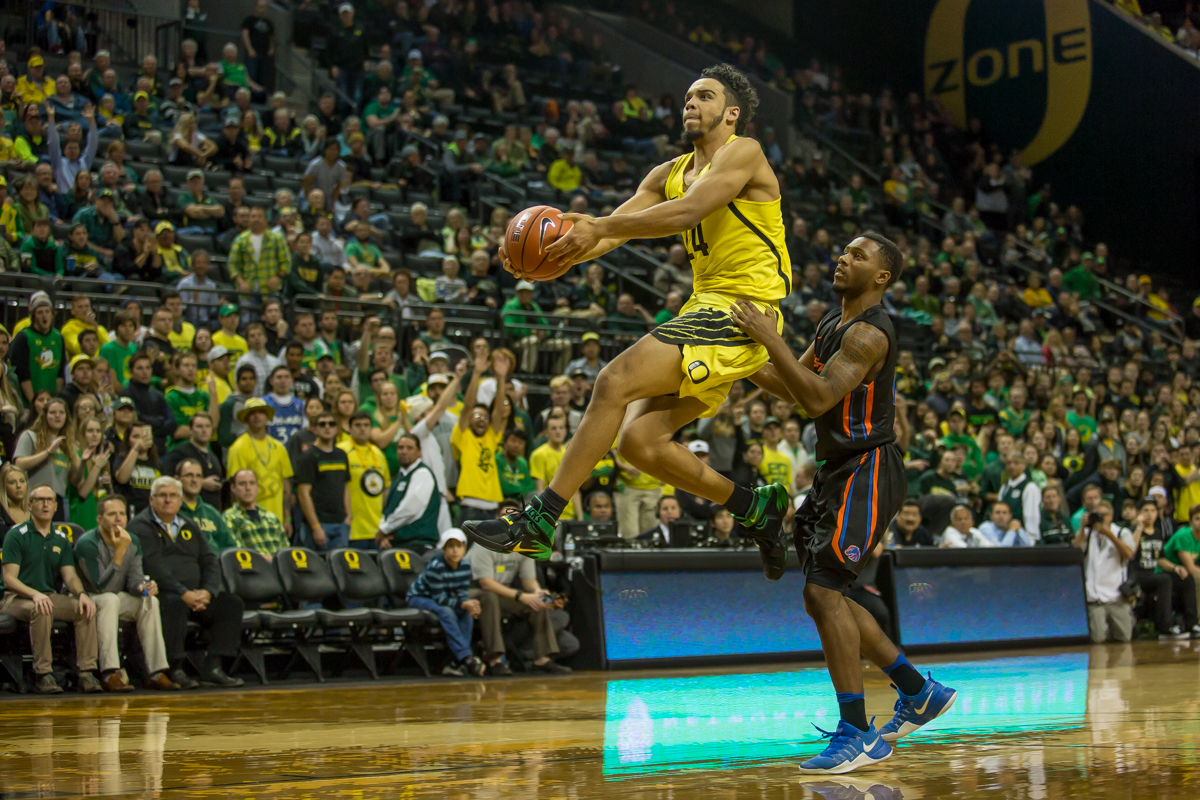 Oregon forward Dillon Brooks (#24) flies through the air after getting fouled by Boise State guard Marcus Dickinson (#0) on the one of the last plays of the game. After trailing for most of the game, the Oregon Ducks defeated the Boise State Broncos 68-63. Photo by Dillon Vibes