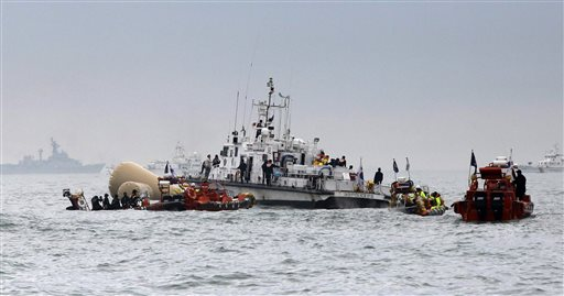 South Korean rescue team members gather to look for passengers near the buoys installed to mark the sunken 6,852-ton ferry Sewol in the water off the southern coast near Jindo, south of Seoul, South Korea.