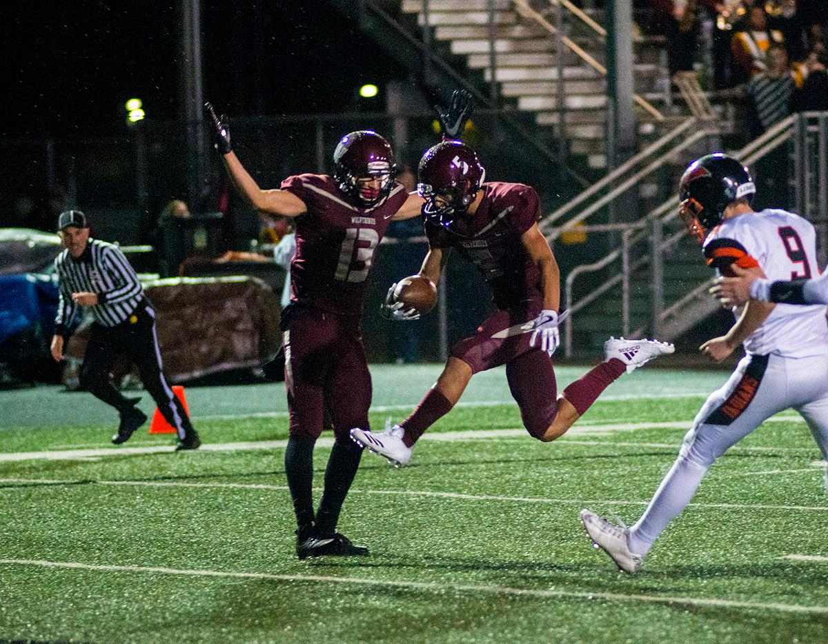 Willamette Wolverines Tanner Branson (#5) crosses the end zone line for a touchdown in the first half. Roseburg Indians defeated Willamette Wolverines 21-20 at Wolverine Stadium on Friday night in Eugene. Photo by Rhianna Gelhart, Oregon News Lab