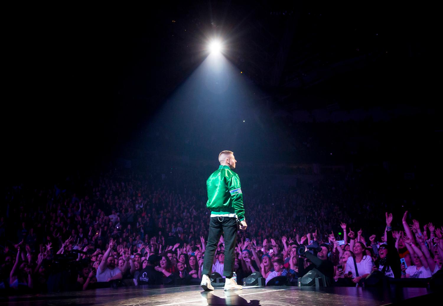 He's home! After being on his Gemini album tour for months, the local rapper came home to play a packed crowd at the Key Arena in Seattle Friday, December 22, 2017. This is the first of two shows Macklemore is playing at the Key, the second being Saturday night December 23, 2017. The Seattle dates sold out within minutes of going online, and the crowds were packed to the brim both nights. (Image: Sy Bean / Seattle Refined)