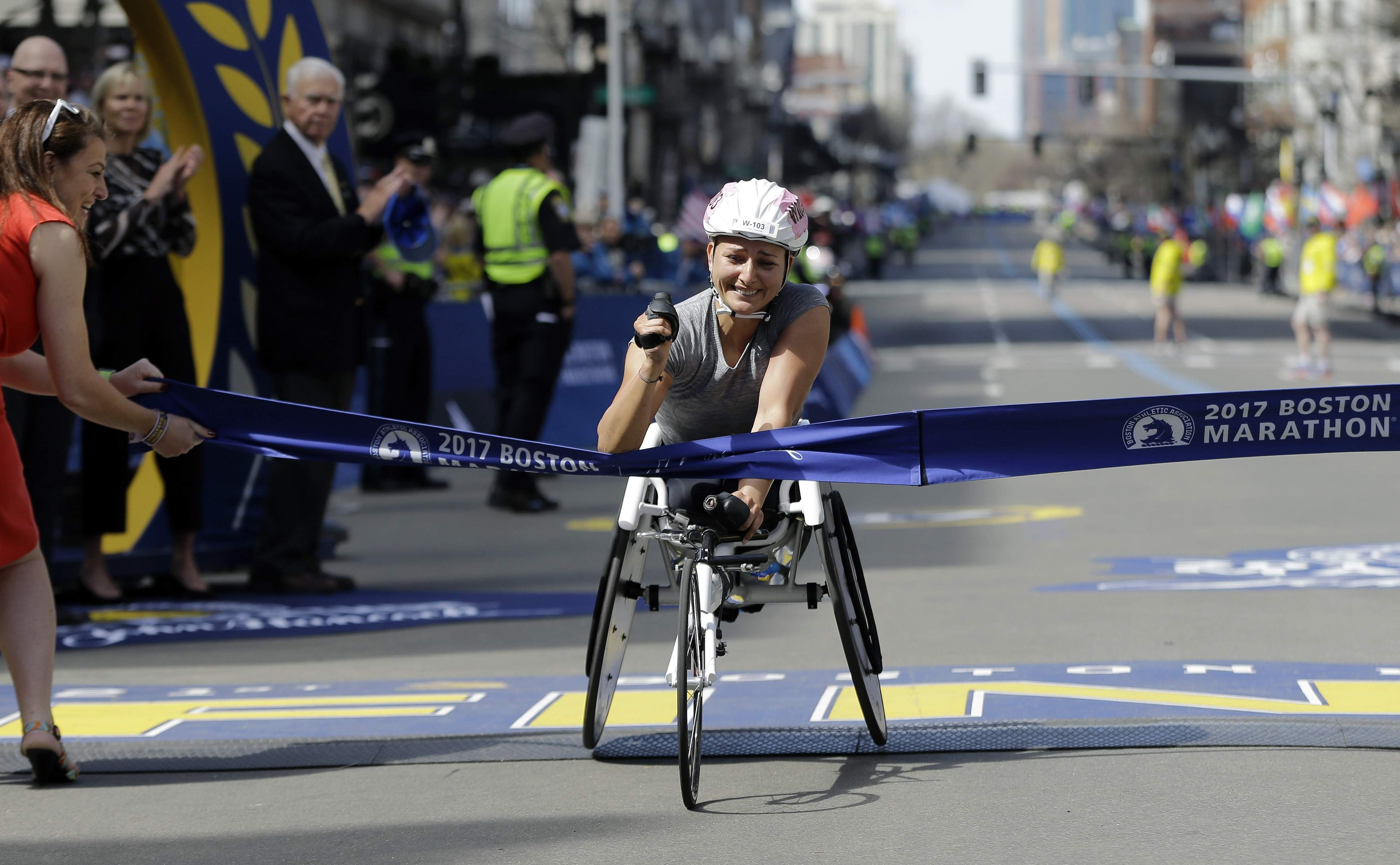 Manuela Schar, of Switzerland, wins the women's wheelchair division in the 121st Boston Marathon on Monday, April 17, 2017, in Boston. THE ASSOCIATED PRESS