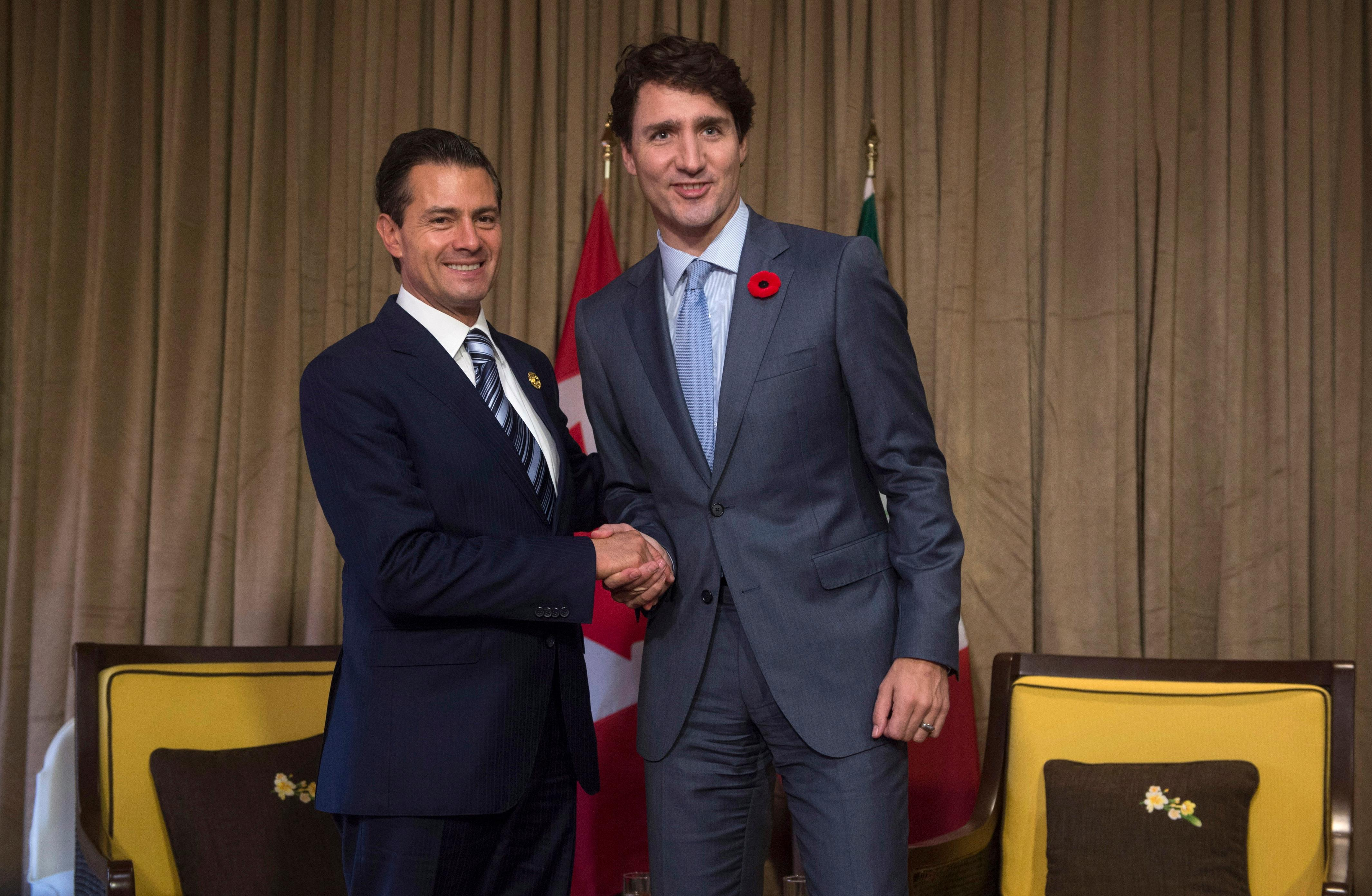 Canadian Prime Minister Justin Trudeau meets with Mexican President Enrique Pena Nieto during a bilateral meeting at the APEC Summit in Da Nang, Vietnam Friday, Nov. 10, 2017.   (Adrian Wyld/The Canadian Press via AP)