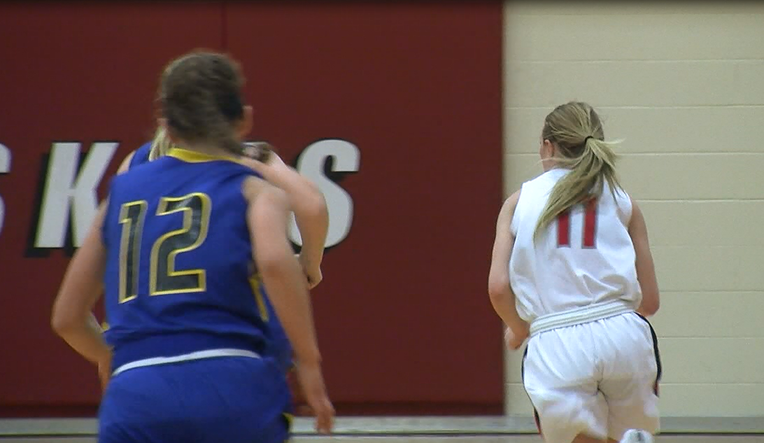 Adyson Narber (11) dribbles up court in a game against Seward, Jan. 22, 2016 (NTV News)