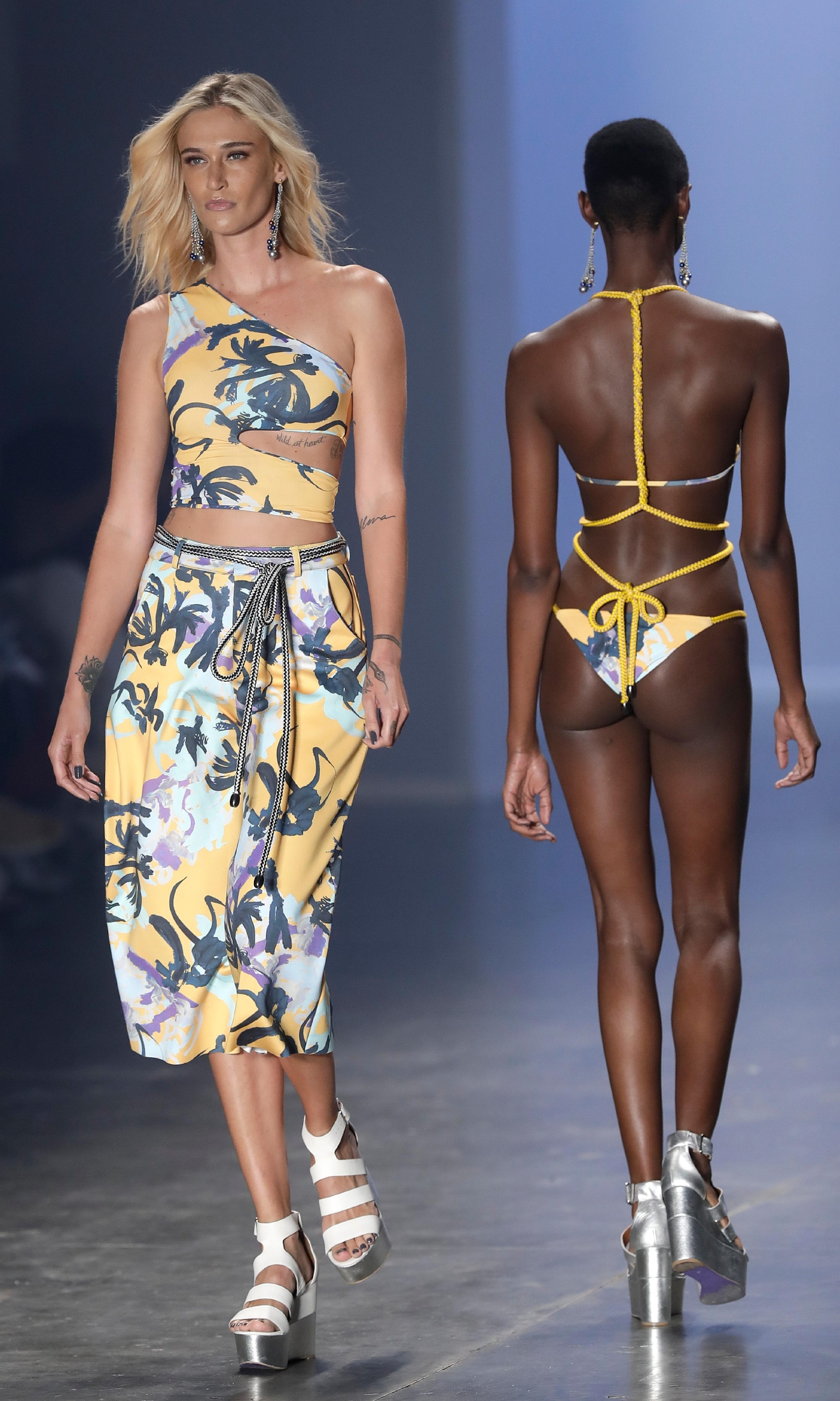 Models wear creations from the PH Praia collection during the Sao Paulo Fashion Week in Sao Paulo, Brazil, Friday, March 17, 2017. (AP Photo/Andre Penner)