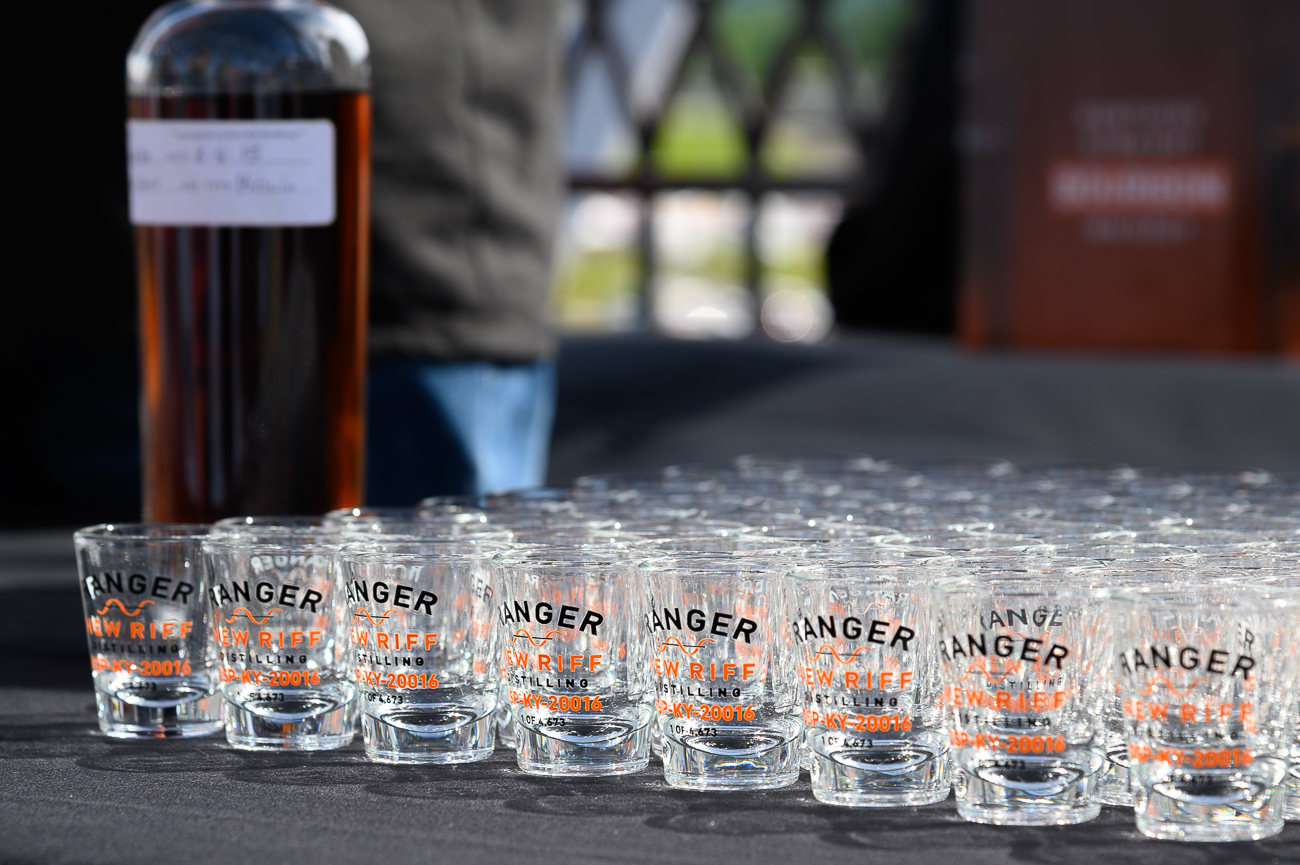 Bottles of New Riff's Kentucky Straight Rye Whiskey and Bourbon were poised for pouring before the tug of war contest began. The first 500 people who attended the event received a commemorating glass. / Image: Phil Armstrong // Published: 6.14.19