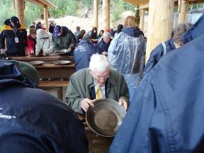 Holiday Vacations tour director panning for gold