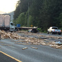 Eastbound I-90 reopens after lumber truck spills load near North Bend