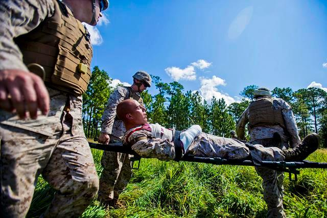 Marines transport a simulated casualty during a mass casualty evacuation exercise on Marine Corps Base Camp Lejeune, N.C., Aug. 7, 2013.