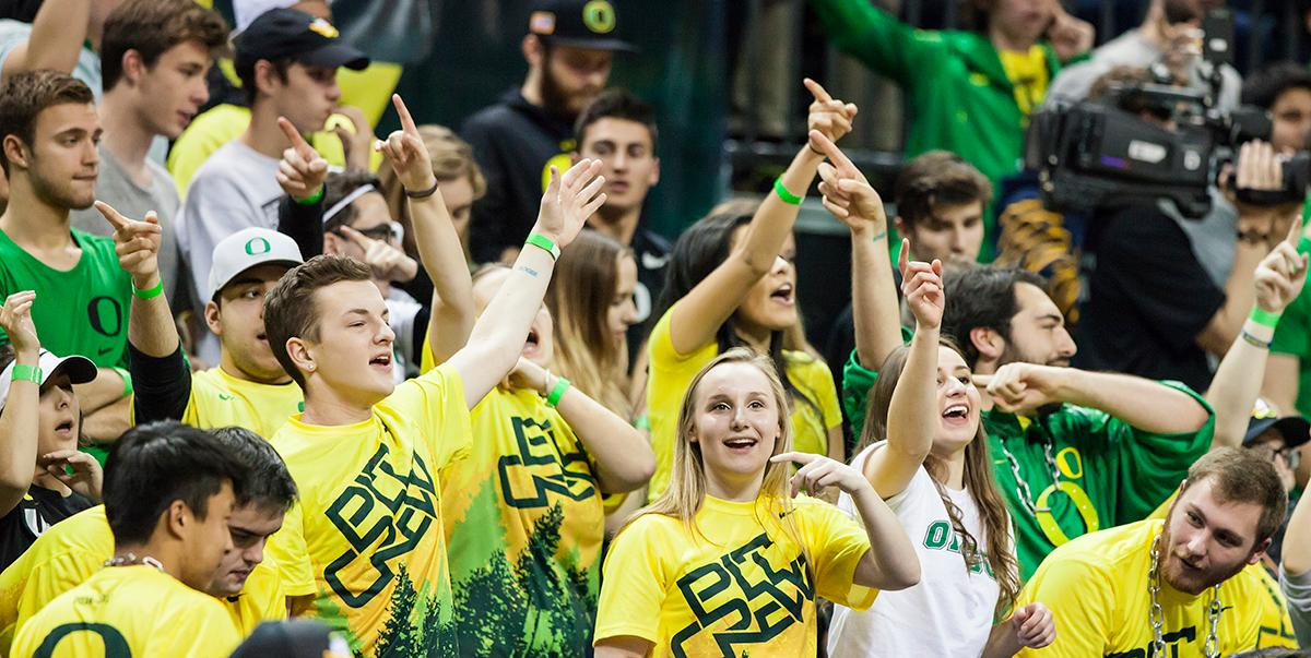 The Pit Crew cheers on Oregon in the final seconds of the game. The Oregon Ducks defeated the Arizona State Sun Devils 71 to 70. Photo by Ben Lonergan, Oregon News Lab