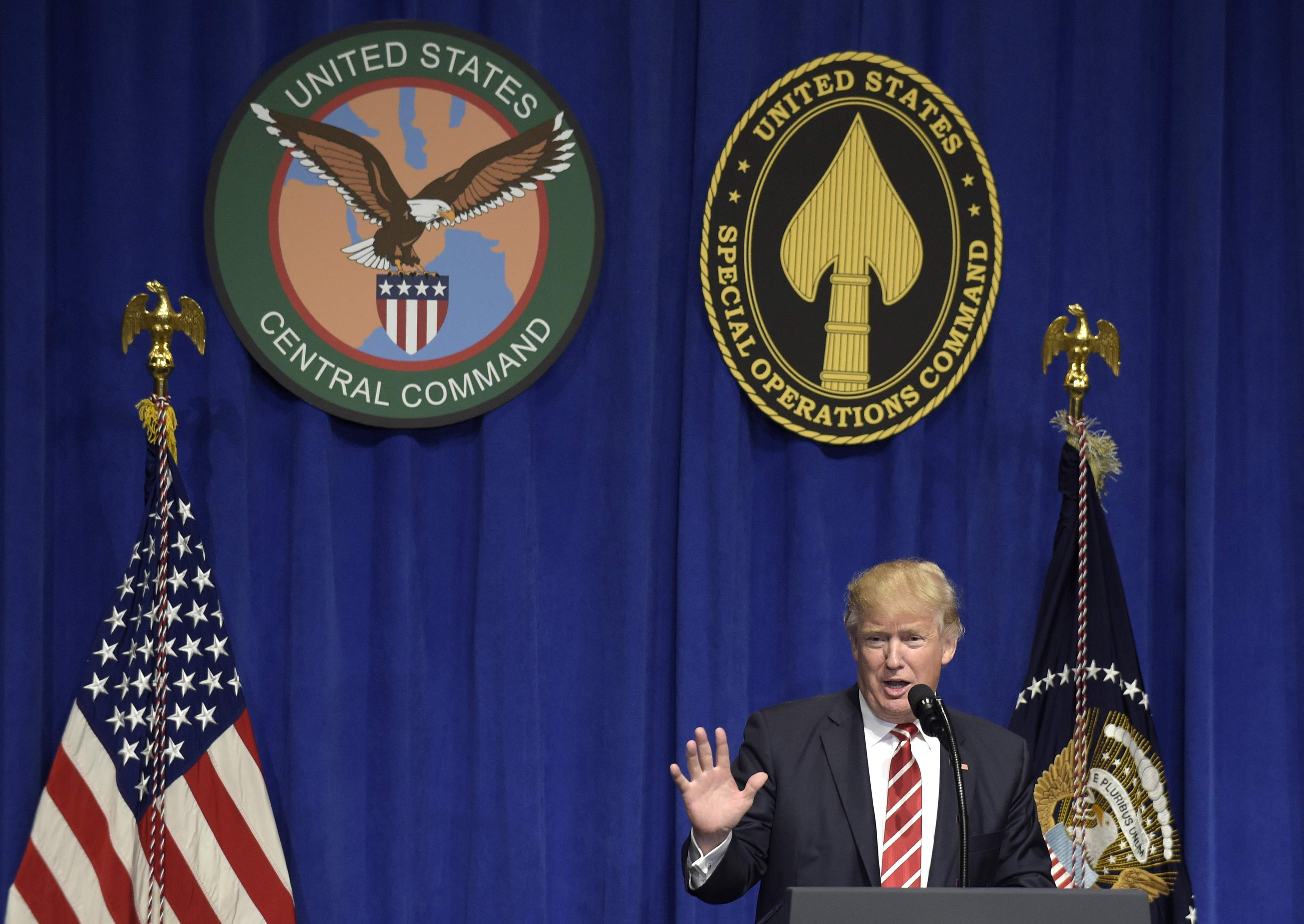 DAY 18 - In this Feb. 6, 2017, file photo, President Donald Trump speaks to troops while visiting U.S. Central Command and U.S. Special Operations Command at MacDill Air Force Base in Tampa, Fla. (AP Photo/Susan Walsh, file)