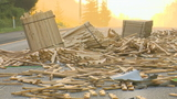 Lumber truck spills load onto interstate, blocks traffic