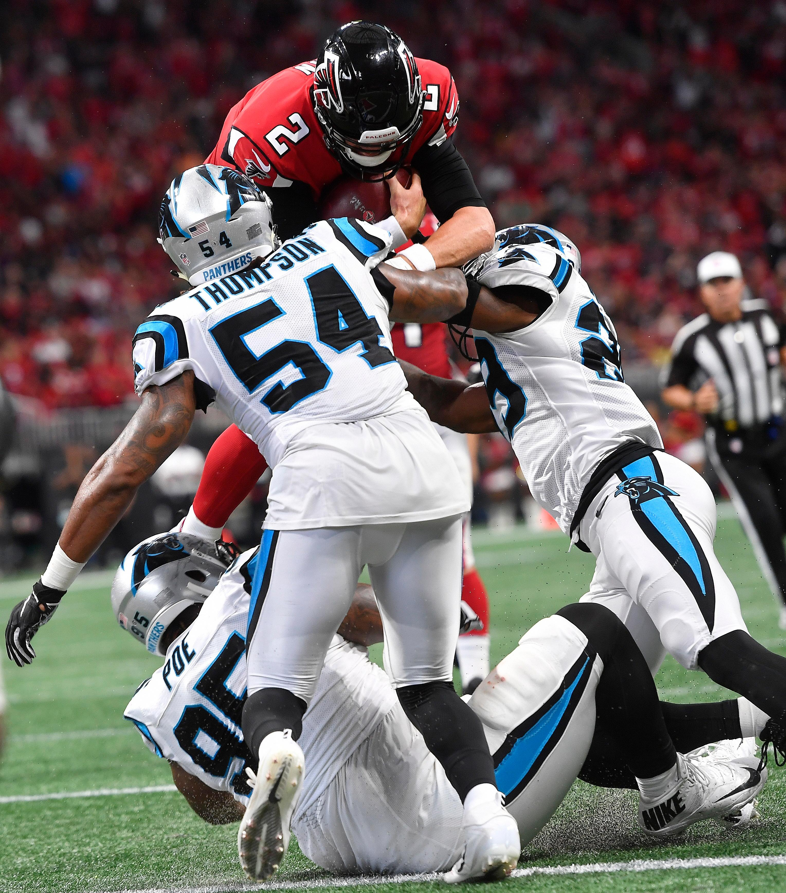 Atlanta Falcons quarterback Matt Ryan (2) leaps for a touchdown as Carolina Panthers linebacker Shaq Green-Thompson (54) defends during the second half of an NFL football game, Sunday, Sept. 16, 2018, in Atlanta. The Atlanta Falcons won 31-24. (AP Photo/John Amis)