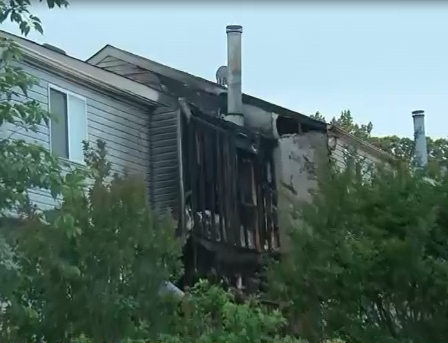 Townhouse fire rattles neighborhood with sound of explosion in Lorton, Va.  Friday, May 12, 2017 (ABC7 photo)