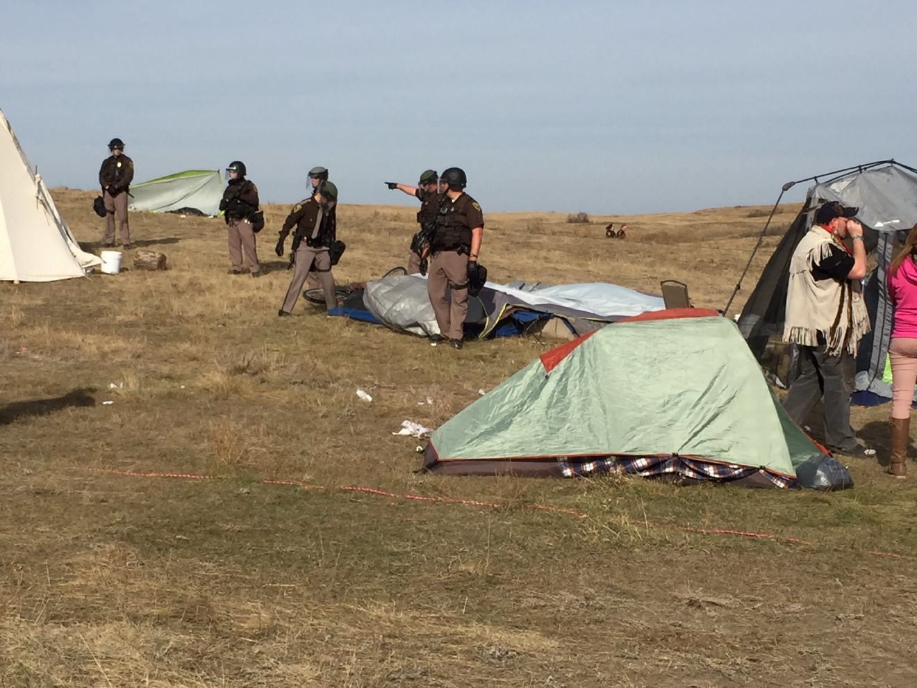 Law enforcement officers move in during a Dakota Access pipeline protest on Thursday, Oct. 27, 2016, near Cannon Ball, N.D. The months-long dispute over the four-state, $3.8 billion pipeline reached a crisis point when the protesters set up camp on land owned by pipeline developer Energy Transfer Partners. The disputed area is just to the north of a more permanent and larger encampment on federally-owned land where hundreds of protesters have camped for months.   Caroline Grueskin/The Bismarck Tribune via AP)