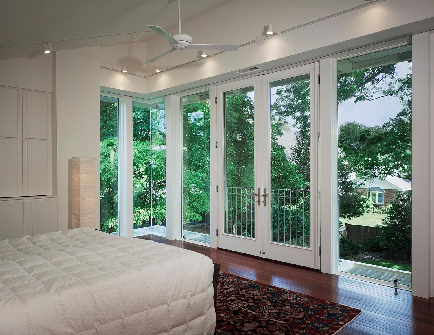 Situated above the new great room, the view from the new master bedroom with sloped ceilings and nine-foot high doors.(Hoachlander Davis Photography)