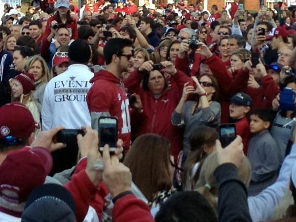 Alabama fans snap pictures of AJ McCarron during the BCS Champions parade on Saturday, January 19, 2013.