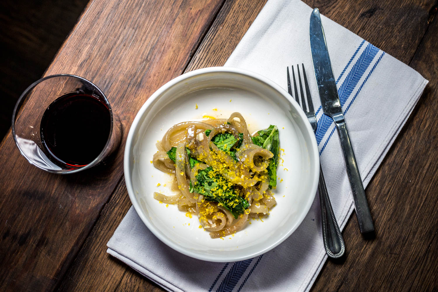 Pig Skin Carbonara: hand-sliced pig skin noodles tossed lightly in white wine and butter with arugula and topped with grated cured egg yolk / Image: Catherine Viox // Published: 10.16.19