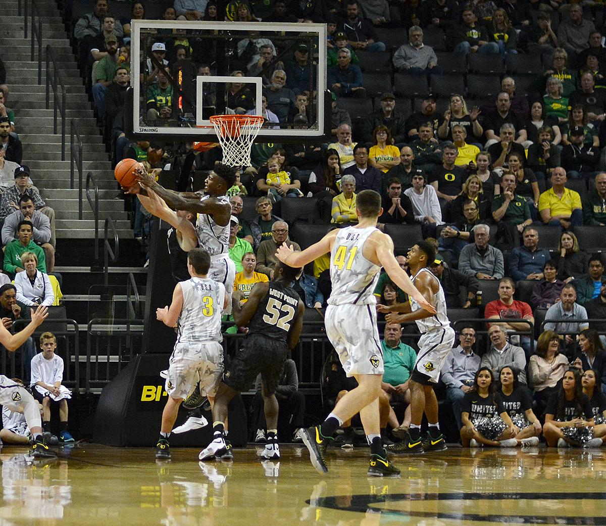 Ducks' Jordan Bell (#1) fights to come down with the rebound. In front of a sold out crowd, Oregon defeated Army 91-77 on opening night. Photo by Jacob Smith, Oregon News Lab