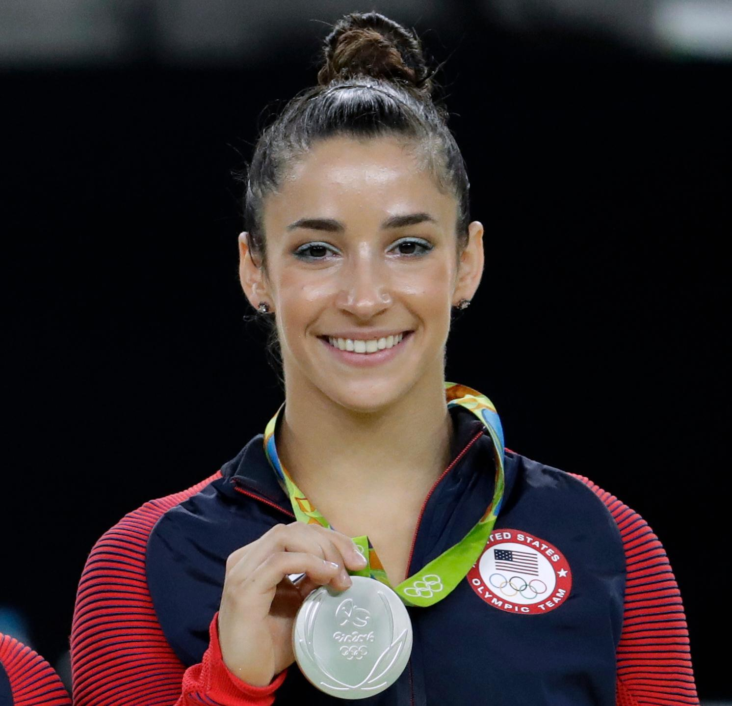 FILE - In this Aug. 16, 2016, file photo, United States' Aly Raisman shows off her silver medal after the artistic gymnastics women's apparatus final at the 2016 Summer Olympics in Rio de Janeiro, Brazil. (AP Photo/Dmitri Lovetsky, FIle)